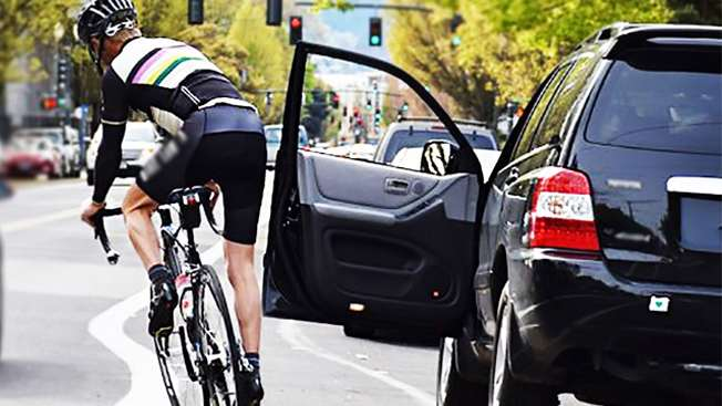 b3e183f3579 One of the many hazards for cyclists is collision with an opened car door